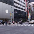 People on Main street of High end Ginza district of Tokyo with the official Apple store. — Stock Photo #73728607