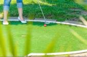 Close-up Mini Golf hole with bat and ball — Stock Photo