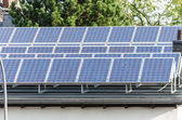 Solar panels on a flat roof — Stock Photo