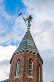 Church spire with figure — Stock Photo