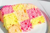 Colorful checkered piece of cake — Stock Photo