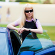 Blonde business  woman next car — Stock Photo #52344451