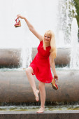 Blonde  woman in red dress and shoes — Stock Photo