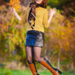 Woman in beige sweater and black leather skirt jump — Foto de Stock   #56501897