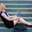 Blonde business woman with tablet — Stock Photo #56567409
