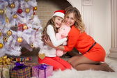 Christmas mother and daughter red clothes — Stock Photo