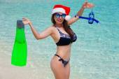 Maldives, women, flippers, mask and tube, christmas hat — Stock Photo