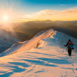 A man in mountain sunset winter — Stock Photo #65720695