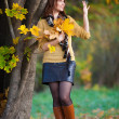 Woman in beige sweater and black leather skirt — Stock fotografie #65724665