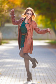 Woman  brown  leather  coat — Stock Photo