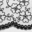 Black flowers and leaves lace material texture macro shot — Stock Photo #58226859