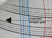 Sewing drawing with straight grain direction sign — Stock Photo
