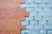 Red brick wall with damaged sidewall. — Stock Photo