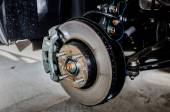 Front disc brake on car in process of new tire replacement. The — Stock Photo