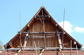 Teak timber roof structure and tile decorate under construction — Photo