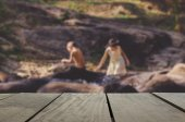 Defocus and blur image of terrace wood and children playing water stream for background usage — Stock Photo