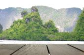 Defocus and blur image of terrace wood and Beautiful mountain midst of andaman sea for background usage — Stock Photo
