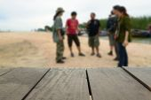 Defocused and blur image of terrace wood and traveller negotiation about trip planning for background usage — Foto Stock
