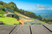 Defocused and blur image of terrace wood and military bunker for background usage — Stock Photo