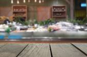 Defocus and blur image of terrace wood and Supermarket blur background in seafood devision for background usage — Stock Photo