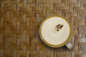 Cappuccino coffee on met asian ancient style — Stock Photo