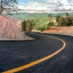 Beautiful asphalt road and sharp curve climb on mountain — Stock Photo #76865565