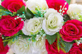 Beautiful bouquet of red roses and white rose — Stock Photo