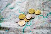 Money euro coins and map for vacation — Stock Photo
