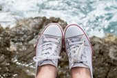 Sneakers at sea — Stock Photo