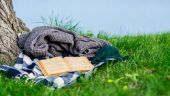 Abandoned book and cover waiting in nature — Stock Photo