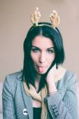 Reindeer girl - tongue out - funny — Stock Photo