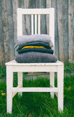 Striped wool textures in autmn colors on chair — Stock Photo