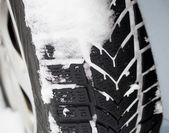 Winter tire with snow — Stock Photo