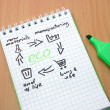 Notepad with product life cycle and word eco. Recycling — Stock Photo #59280157