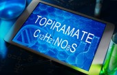The chemical formula of  Topiramate on a tablet with test tubes — Stock Photo