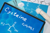 Tablet with the chemical formula of  Cysteine. — Stock Photo