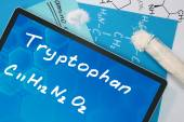 Tablet with the chemical formula of  Tryptophan. — Fotografia Stock
