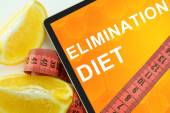Elimination diet on tablet. — Stock Photo