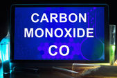 Tablet with chemical formula of  carbon monoxide . — Stock Photo
