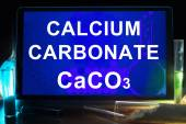 Tablet with chemical formula of  calcium carbonate. — Stock Photo