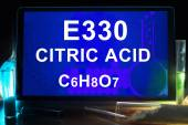 Tablet with chemical formula of  citric acid Е330. — Stock Photo