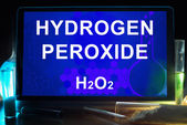 Tablet with chemical formula of  hydrogen peroxide. — Stock Photo
