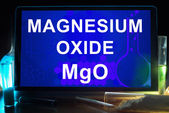 Tablet with chemical formula of  magnesium oxide. — Stock Photo