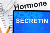 Papers with hormones list and tablet  with words  Secretin. — Stock Photo