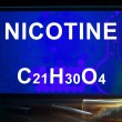 Постер, плакат: Tablet with chemical formula of nicotine