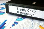 Graphs and file folder with label supply chain managment. — Stock Photo