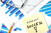 Papers with graphs and words time for success. — Stock Photo