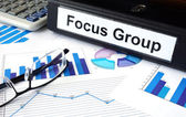 File folder with words Focus Group and financial graphs. — Stock Photo