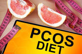 Tablet with  PCOS diet . — Fotografia Stock