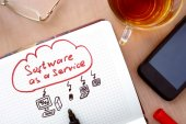 Notepad with words SaaS software as a service concept. — Stock Photo